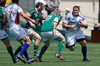 31 May 2009: Mike MacDonald of USA rushes the ball away from Ireland defenders during the Rugby game at Buck Shaw Stadium in Santa Clara, California.   Ireland defeated USA, 27-10.