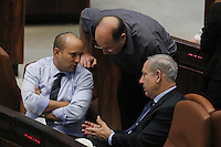 "Israel's Prime Minister Benjamin Netanyahu (R) and Defense Minister Moshe (""Boogie"") Yaalon (C) and Minister of Economics Naftali Bennett (L) during a plenum session voting on the state budget, in the Knesset, Israel's Parliament, in Jerusalem, late night July 29, 2013. The Knesset approved the State Budget at second and third readings in the early hours of Tuesday morning in a 58-43 vote, following a 15-hour parliamentary session. Photo by Oren Nahshon"