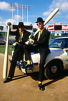 OAKLAND, CA - Mark McGwire (r) and Jose Canseco of the Oakland Athletics pose for a Bash Brothers poster after a game at the Oakland Coliseum in Oakland, California in 1987. Photo by Brad Mangin