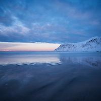 Soft winter light reflecting on Skagsanden beach, Flakstadøy, Lofoten Islands, Norway