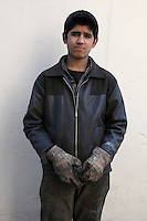 "Ali Ghosi, 16, is a blacksmith. Ali works 12 hours per day, six days per week, and earns USD $120 per month. It is legal to work in Iran from the age of 15. He was asked what his dreams are: ""My desire is to continue with my job, to marry and have three children."""