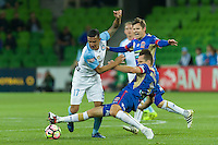 Melbourne, 10 November 2016 - TIMOTHY CAHILL (17) of Melbourne City and NIGEL BOOGAARD (4) of the Jets fight for the ball in the round 6 match of the A-League between Melbourne City and Newcastle Jets at AAMI Park, Melbourne, Australia. Melbourne won 2-1 (Photo Sydney Low / sydlow.com)