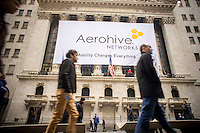 A banner on the front of the New York Stock Exchange celebrates the first day of trading for Aerohive Networks on Friday, March 28, 2014. Opening at $10 per share the stock dipped to $8.81 before floating up to $9.99, giving the company a valuation of $436 million on 7.7 million shares.   (© Richard B. Levine)