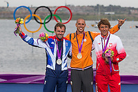 ENGLAND, Weymouth. 7th August 2012. Olympic Games. Men's RS:X Class. Medal Ceremony. L-R Nick Dempsey (GBR) Silver Medalist. Dorian van Rijsselberge (NED) Gold Medalist, and Przemyslaw Miarczynski (POL) Bronze Medalist.