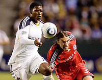 LA Galaxy forward Edson Buddle (14) battles Toronto FC defender Maksim Usanov (33). The LA Galaxy and Toronto FC played to a 0-0 draw at Home Depot Center stadium in Carson, California on Saturday May 15, 2010.  .