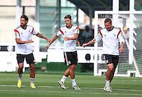 Sami Khedira, Mesut Ozil and Lukas Podolski of Germany during training ahead of tomorrow's World Cup Final
