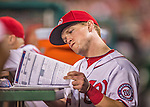 20 May 2014: Washington Nationals outfielder Nate McLouth reads scoring data in the dugout during a game against the Cincinnati Reds at Nationals Park in Washington, DC. The Nationals defeated the Reds 9-4 to take the second game of their 3-game series. Mandatory Credit: Ed Wolfstein Photo *** RAW (NEF) Image File Available ***