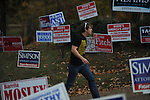 A man walks past campaign signs to vote at the polls at the Chamber of Commerce in Oxford, Miss. on Tuesday, November 8, 2011. Mississippians go to the polls today for state and local elections, as well as referendums including the so-called Personhood Amendment.