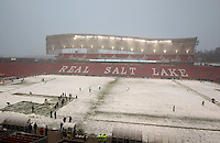 Players warm up on a snow covered field before the Women's USA Mexico match at Rio Tinto Stadium March 31, 2010 in Salt Lake City, Utah. The USA women won the match over Mexico 1-0.