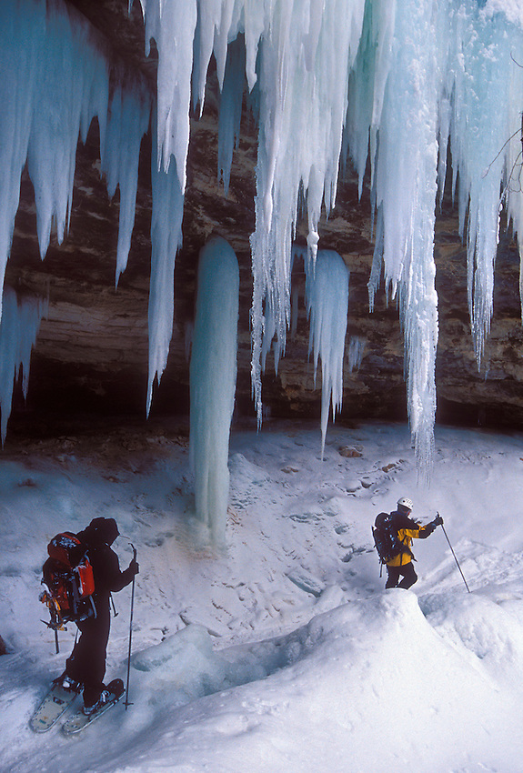 Ice climbers pass cliffs and ice formations in Pictured Rocks National Lakeshore near Munising, Mich.