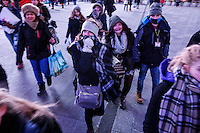 People walk as they visit Times Square as the temperatures are set a record low in New York. 15.02.2015. Kena Betancur/VIEWpress.