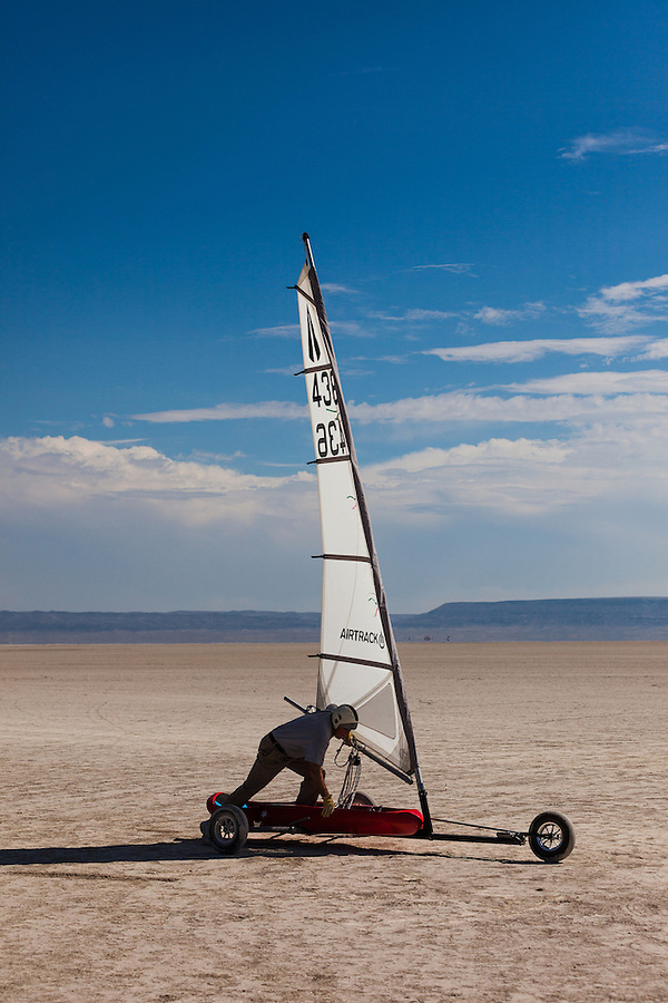 A mature male pushes his land sailer preparing to cross the Alvord Desert on a windy day in Southeast Oregon.