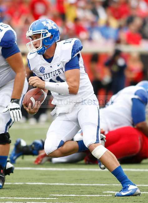 Sophomore quarterback Maxwell Smith runs with the ball during the first half of the UK vs. UL football game at Papa John's Cardinal Stadium in Louisville, Ky., on Sunday, September 2, 2012. Photo by Tessa Lighty   Staff