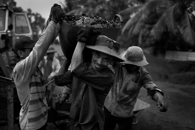 Vietnamese coal workers outside of Ho Chi Minh City, Vietnam.