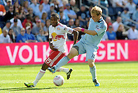 Sporting KC defender Seth Sinovic (16) holds off the challenge from Red Bulls midfielder Dane Richard (19).. Sporting Kansas City defeated New York Red Bulls 2-1 at LIVESTRONG Sporting Park, Kansas City, Kansas.