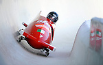 15 December 2007: Italy 1 pilot Simone Bertazzo with brakeman Samuele Romanini exit a turn during their first run at the FIBT World Cup Bobsled Competition at the Olympic Sports Complex on Mount Van Hoevenberg, at Lake Placid, New York, USA. ..Mandatory Photo Credit: Ed Wolfstein Photo