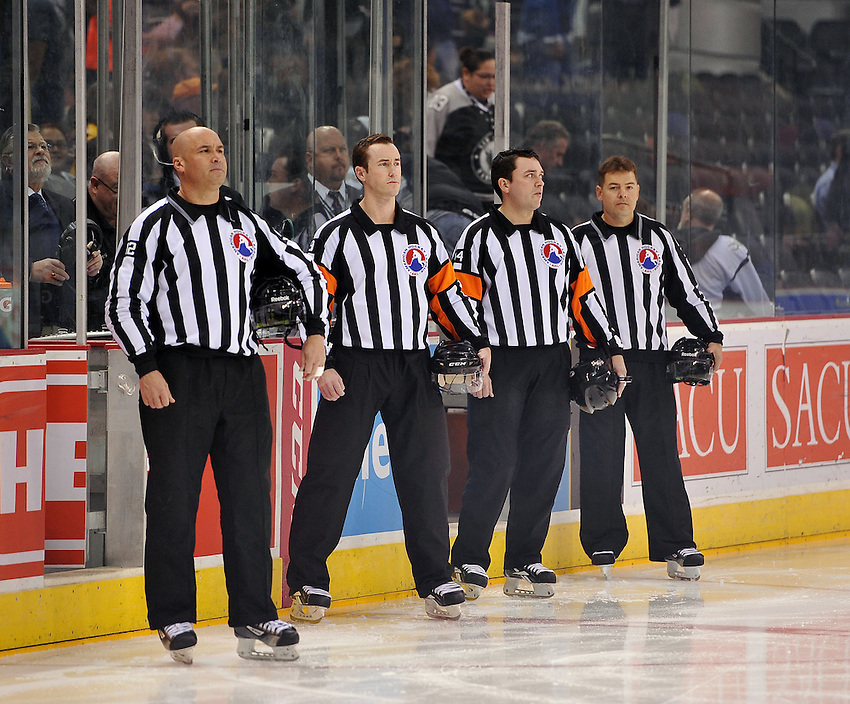 Officials Carl Sasyn (from left), J.M. McNulty, Jamie Koharski, and Fred Hudy, assemble for the national anthem before an AHL hockey game between the Milwaukee Admirals and the San Antonio Rampage, Thursday, Jan. 16, 2014, in San Antonio. San Antonio won 5-4 in a shootout. (Darren Abate/AHL)