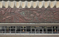 Frieze on a building on the junction of Karl Marx Allee and Otto-Brown Strasse, Art Deco style, with shop below, Berlin, Germany. Picture by Manuel Cohen