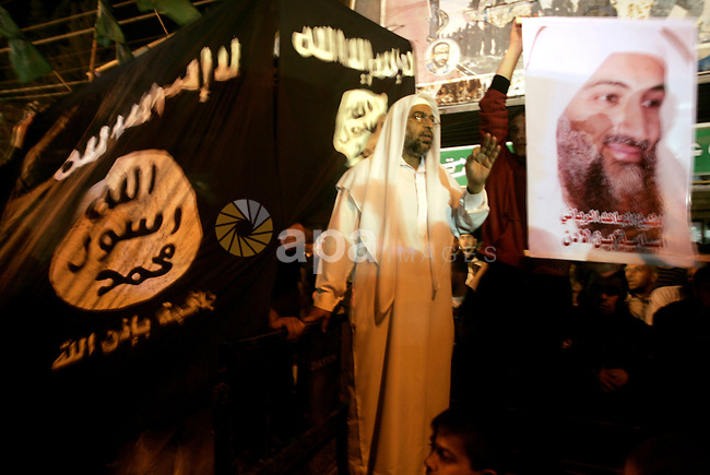 Palestinian Salafi group holds a picture of Osama bin Laden, during a protest in Rafah, southern Gaza Strip, Friday, May 6, 2011. Al-Qaida on Friday confirmed the killing of Osama bin Laden and warned of retaliation, saying Americans' 'happiness will turn to sadness. Photo by Abed Rahim Khatib
