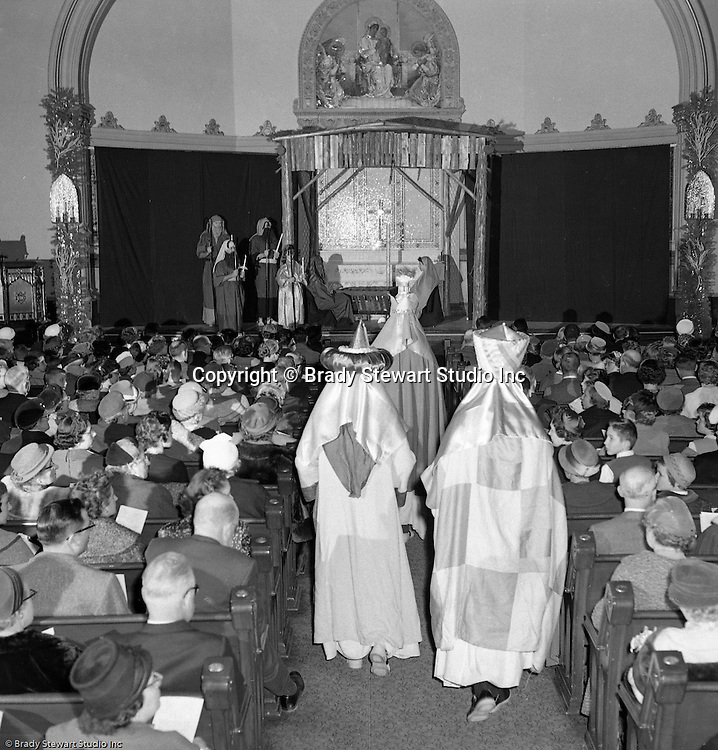 Pittsburgh PA: View of the Christmas play; the birth of baby Jesus, at the First Luthern Church on Grant Street in Pittsburgh - 1958.  Members of the congregation doned period clothing the recreate Christmas night 1958 years earlier.  The 3 wise men approaching the stable with baby Jesus and Mary and Joseph