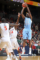 Jan. 8, 2011; Charlottesville, VA, USA;  North Carolina Tar Heels forward Harrison Barnes (40) shoots over Virginia Cavaliers center Assane Sene (5) and Virginia Cavaliers guard K.T. Harrell (24) during the game at the John Paul Jones Arena. Mandatory Credit: Andrew Shurtleff