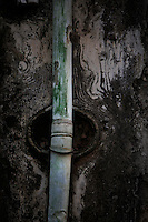 Detail of a drain pipe in Via Roma in Ortigia, Syracuse, Sicily, pictured on September 14, 2009, in the morning. The 2,700 year old Syracuse is a province and a city in southern Italy on the Island of Sicily. The island Ortigia is the historic centre of Syracuse. Today the city is a UNESCO World Heritage Site. Founded by Ancient Greek Corinthians and allied with Sparta and Corinth, it was a very powerful city-state and one of the major powers of the Mediterranean.  In the 17th century it was heavily destroyed by an earthquake. Many buildings date back to the  19th century when it regained importance. Picture by Manuel Cohen.