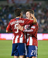 CARSON, CA – June 3, 2011: Chivas USA  players Paolo Nagamura (5) and Ben Zemanski (21) celebrate the Chivas USA goal during the match between Chivas USA and Portland Timbers at the Home Depot Center in Carson, California. Final score Chivas USA 1, Portland Timbers 0.