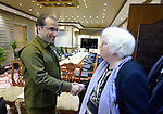 Iraq's Deputy Interior Minister Aqeel al-Khazali (left) greets Clare Amos, a program executive for the World COuncil of Churches, during the visit of an ecumenical delegation to al-Khazali's office in Baghdad on January 21, 2017.