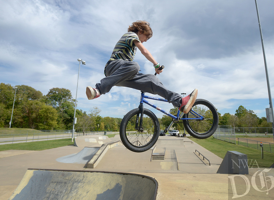 NWA Democrat-Gazette/BEN GOFF @NWABENGOFF<br /> Trace McRell of Springfield, Mo. works on a 'tail whip' on Sunday Oct. 10, 2016 while riding at the skate park at Memorial Park in Bentonville.