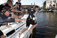 Adam Minoprio goes for the traditional dunking after winning Match Race Germany 2010. World Match Racing Tour. Langenargen, Germany. 24 May 2010. Photo: Gareth Cooke/Subzero Images/WMRT