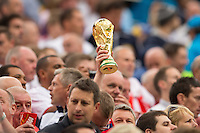 An England fan holds a world cup trophy in the air