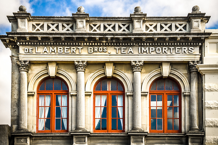 Historic stone building with bright red windows, Oamaru, South Island, New Zealand - stock photo, canvas, fine art print