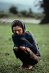 Tea leaf picker in the rain, Sylhet, Bangladesh, 1983<br />