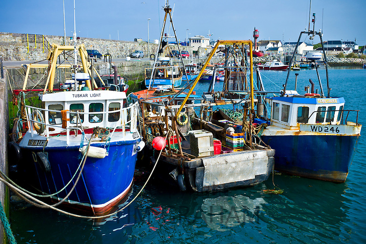 Traditional brightly coloured fishing boats and trawlers in County Wexford, Southern Ireland