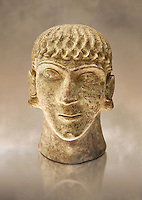 First half of the 6th century B.C Etruscan clay head of a young man made in Chiusi, inv 94612, National Archaeological Museum Florence, Italy