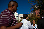 Dr. Pete Rhee,trauma director at University Memorial Hospital speaks to press about the condition of Rep. Gabreille Giffords on January 9th, 2011.  An impromptu memorial was erected on the lawn in front of the hospital for Giffords and the other victims of the shooting.  Ten were transported to the hospital in the moments following the gunfire....  Scenes from Tucson, Arizona in the days following a mass shooting that left six dead and [number] injured.  The shooter, identified as Jared Loughner, was captured at the scene and charged in federal court on January 9th, 2011.  Among the injured was democratic congresswoman Gabrielle Giffords.  The dead included a federal judge, a nine year-old girl, and several septaugenarians who had all come to see the congresswoman at one of her 'Congress on the Corner' events.