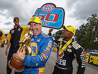 Aug 20, 2016; Brainerd, MN, USA; NHRA funny car driver Ron Capps (left) celebrates with teammate Antron Brown after winning the Protect the Harvest Nationals from Seattle, WA that was delayed by rain to run during qualifying for the Lucas Oil Nationals at Brainerd International Raceway. It was the 50th win of Capps career. Mandatory Credit: Mark J. Rebilas-USA TODAY Sports