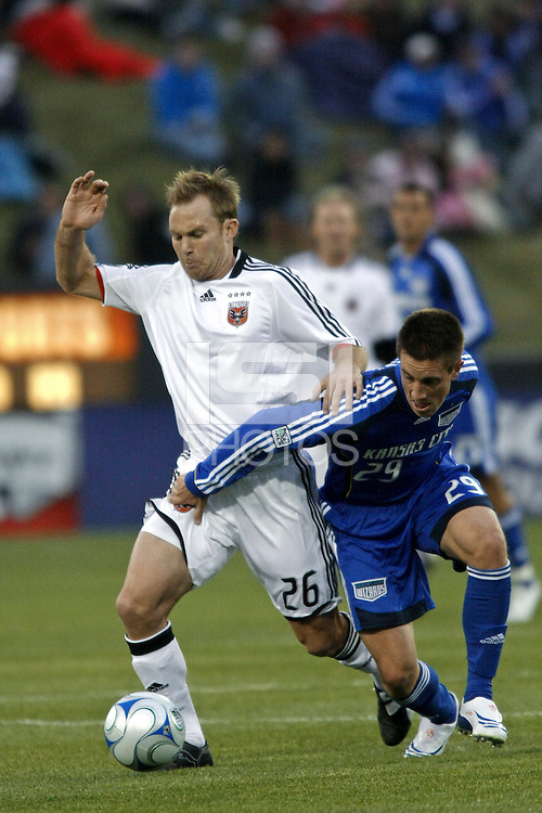 Bryan Namoff of DC United and Ryan Pore of the Kansas City Wizards. The Kansas City Wizards defeated D. C. United 2 - 0 during a Major League Soccer match at CommunityAmerica Ballpark in Kansas City, Kansas on March 29, 2008.