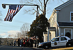 WOODBURY, CT 19 DECEMBER- 121912JS06- An American flag hangs off a bucket truck from Neal Tree Service of Woodbury outside the Munson-Lovetere Funeral Home in Woodbury on Wednesday during calling hours for Sandy Hook Principal Dawn Hochsprung Jim Shannon Republican American