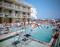 Group of people enjoying the pool at the Rio Motel located in Wildwood, New Jersey. 1960's retro photograph.