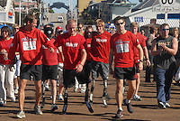 The Gumpathon, a team consisting of six men from the U.S. Marines, Royal Marines, and U.S. Army, run down the Santa Monica Pier on Thursday, November 11, 2010, and complete their two-month, 3,530-mile journey across the United States..The Gumpathon began at the USS Intrepid in New York at 7:30 a.m. on Sept. 11, to raise money for injured service men and women on both sides of the Atlantic. .Money collected goes to the following charities: Help for Heroes, The Royal Marines Charitable Trust Fund, and the US injured Marine Semper Fi Fund. .The team consists of Colour Sergeant Damien Todd, Mark Ormrod, Master Gunnery Sergeant Charles Padilla, Marine, Jamie Jobson, Corporal Lloyd Fenner, and SSgt James Mazzoni-Dalton. ...........