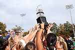 09 November 2014: Wake Forest players hold the championship trophy overhead. The Wake Forest University Demon Deacons played the Syracuse University Orange at Jack Katz Stadium in Durham, North Carolina in the 2014 Atlantic Coast Conference NCAA Division I Field Hockey Championship Game. Wake Forest won the ACC Championship game 2-0.