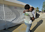 Rose Michel, a 10-year old survivor of the January 12 earthquake in Haiti, lost both her legs when the orphanage she was living in collapsed. Here she gets a hug from Maura Senfre, a volunteer from the Dominican-Haitian Women's Movement (MUDHA).