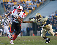 Louisville Cardinal Running Back Kolby Smith eludes Pitt Panther Defensive Back Jemeel Brady on his way to a 19-yard touchdown run as the Cardinals beat the Panthers 48-24 on November 25, 2006 at Heinz Field, Pittsburgh, Pennsylvania.