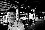 "Mekong Dam Victims - Cambodia. One of the old inhabitants who have decided to move the village up in the hills, far away from the original setting on the riverbank. At least 55.000 people living near the Sesan river in Cambodia's Ratanakiri and Stung Treng provinces continue to suffer due to lost rice production, lost fishing income, drowned livestock and damaged vegetable gardens, and so also great economical losses, because of the unpredictable floodings from the Yali Falls Dam on the other side of the border in Vietnam. To this day, flash floodings have caused the deaths of at least 39 villagers from various ethnic minority groups living along the river. Despite this, four other major hydropower projects are now in operation or under construction on the Sesan River in Vietnam. Known as ""The Mother of Waters"", more than 60 million people depend on the Mekong river and its tributaries for food, fresh water, transport and other aspects of daily life. The construction of big dams is now threatening the life of these people aswell as the vital and unique ecosystem of the river."