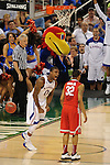 31 MAR 2012:  Thomas Robinson (0) of the University of Kansas explodes after a dunk in front of Lenzelle Smith, Jr. (32) Ohio State University after a dunk during the Semifinal Game of the 2012 NCAA Men's Division I Basketball Championship Final Four held at the Mercedes-Benz Superdome hosted by Tulane University in New Orleans, LA. Kansas defeated Ohio State 64-62 to advance to the national final. Brett Wilhelm/ NCAA Photos