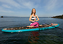PE00302-00...WASHINGTON - Carly Hayden doing paddle board yoga in the Puget Sound at Brackett's Landing North, Edmonds.  (MR #H13)