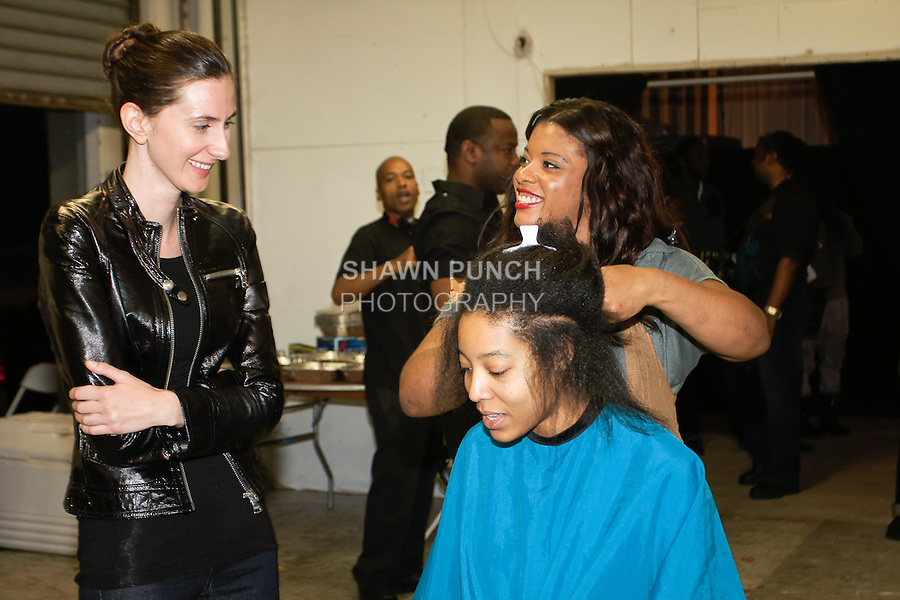 Hair stylist, styles model's hair, backstage during BK Fashion Weekend Spring Summer 2012.