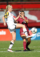 COLLEGE PARK, MD - OCTOBER 21, 2012:  Ashley Spivey (8) of the University of Maryland kicks the ball away from Tiana Brockway (15) of Florida State during an ACC women's match at Ludwig Field in College Park, MD. on October 21. Florida won 1-0.