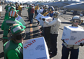 Sailors aboard the aircraft carrier USS Ronald Reagan (CVN 76) take boxes of supplies off a C-2A Greyhound from Fleet Logistics Combat Support Squadron (VRC) 30 on Tuesday, November 9, 2010. The supplies will be transferred from Ronald Reagan to the Carnival cruise ship C/V Splendor, which lost propulsion and electrical power following an engine room fire.  The aircraft carrier USS Ronald Reagan (CVN 76) was diverted from its current training maneuvers at the direction of Commander U.S. Third Fleet, and at the request of the U.S. Coast Guard, to facilitate the delivery of 4,500 pounds of supplies to the cruise ship.  .Mandatory Credit: Haldane Hamilton - U.S. Navy via CNP